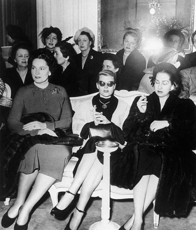 Her Highness The Begum Aga Khan III and her stepdaughter-in-law Rita Hayworth attend a presentation at Christian Dior in 1956