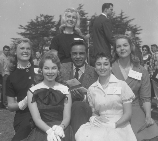 Johnny Mathis judges a San Francisco State beauty contest in 1958.