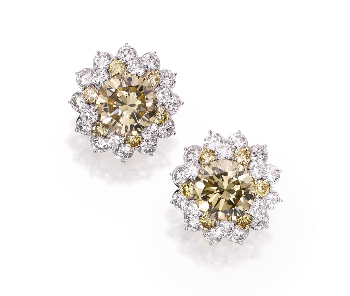 Pair of Platinum, 18 Karat Gold, Colored Diamond and Diamond Earclips, Van Cleef & Arpels