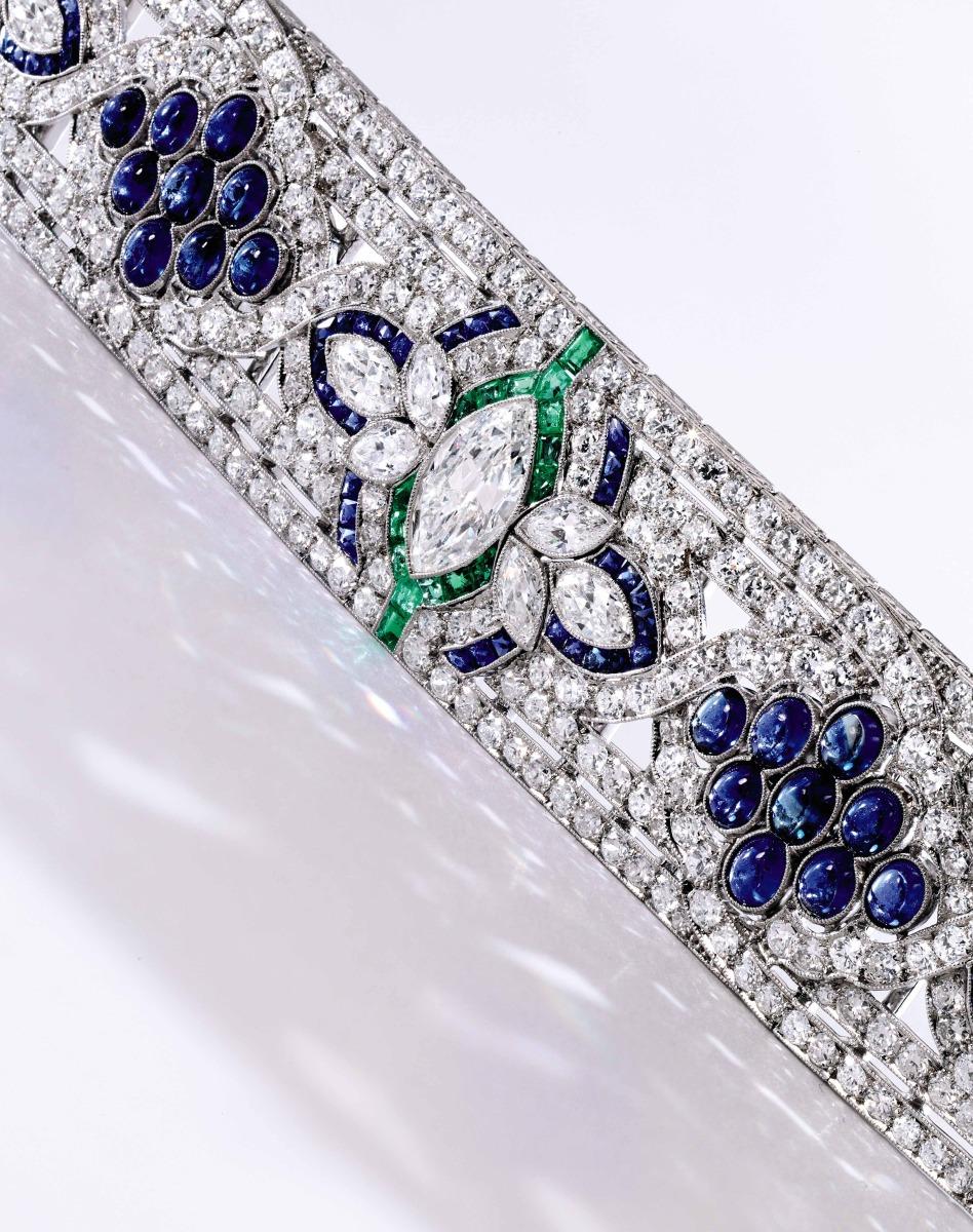 Platinum, Diamond, Sapphire and Emerald Bracelet, Oscar Heyman & Brothers, circa 1925. Estimate $100-150,000.