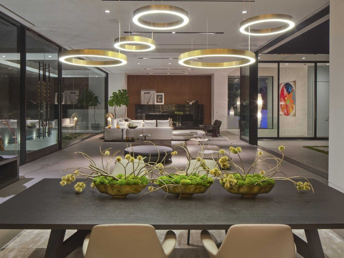 abstract-light-fixtures-hang-from-the-ceiling-at-the-end-of-the-entryway