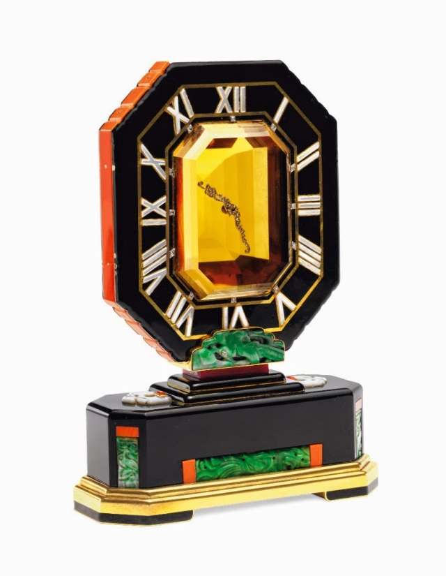 "Clock by Cartier in onyx, mother of pearl, coral, and jade with ""floating"" diamond hands set in a large emerald cut citrine..jpg"