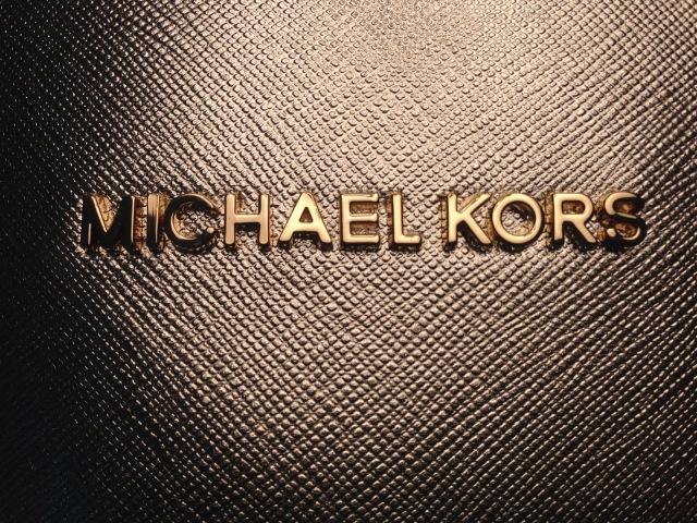 Michael Kors Gold logo.jpg