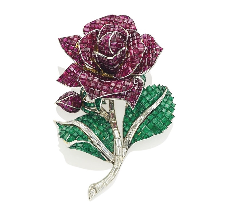A RUBY, EMERALD AND DIAMOND FLOWER BROOCH, BY ROBERT POUGET Begum Om Habibeh Aga Khan